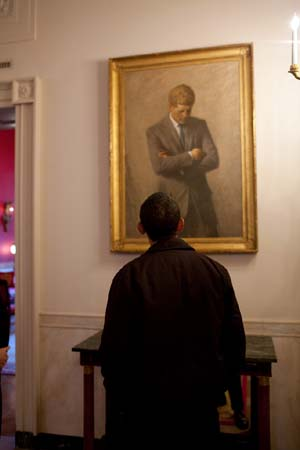 Obama looking at Kennedy painting